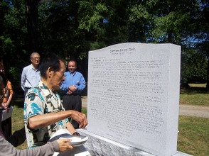 David Kim blessing the monument