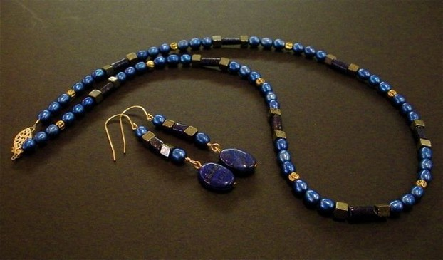 Blue-dyed fresh water pearls, elegant lapis and gold-filled findings make this necklace and earring set.