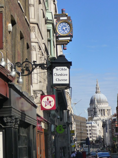 Ye Olde Cheshire Cheese sign with St. Paul's, London