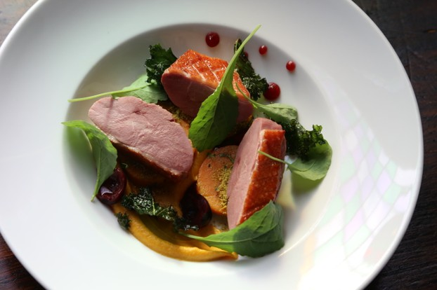 Confit duck breast with sweet potato, kale and cranberry