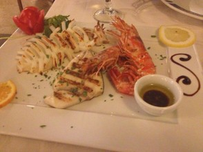 Mixed grilled seafood as served in a restaurant in Naples.