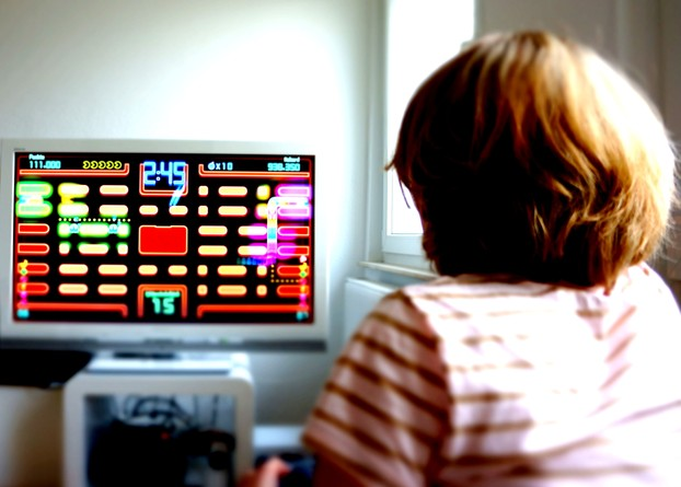 A Girl Playing Pac-Man in 2012