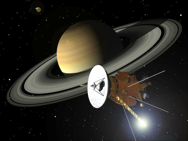 The Cassini unmanned spacecraft orbits Saturn, collects data, and sends it back to earth