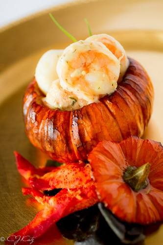 Roasted mini pumpkin with buttered shrimp, scallops and lobster.
