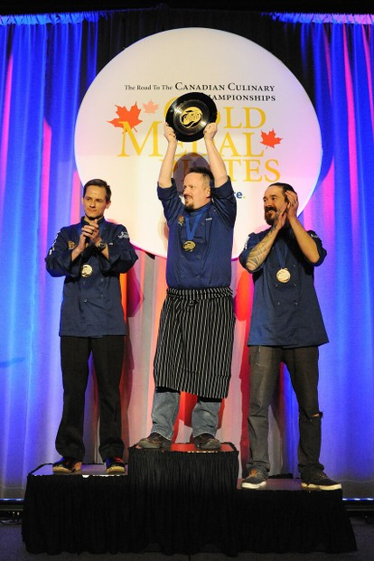 Chef Darren Craddock (centre) winning gold at the 2015 Gold Medal Plates competition.
