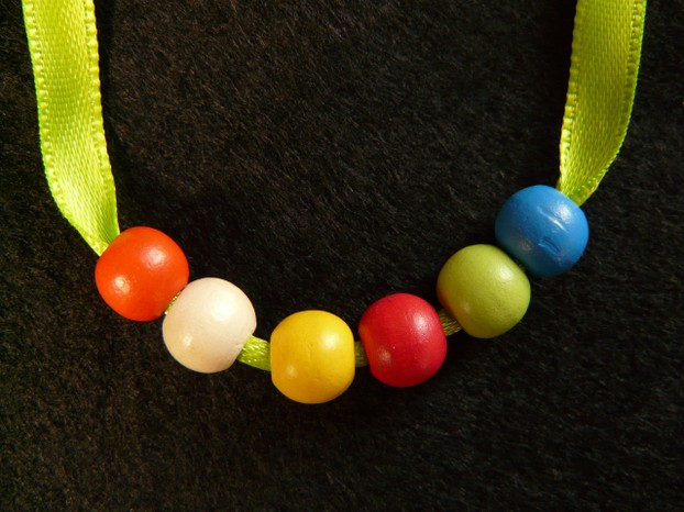 String together a one-of-a-kind necklace or bracelet made of wooden beads and give her a sweet keepsake reminder of you.