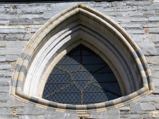 Manhole covers in the shape of the Reuleaux triangle, like the shape of this window, would work because of their constan