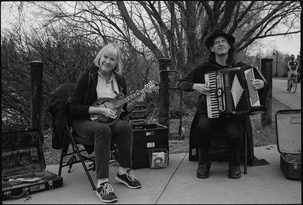 Linda Kitchin (right) and Darcy North (left) busking in the park.
