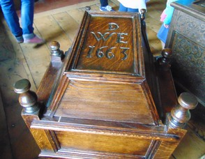 Carved cot dated 1663