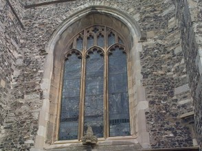 Arched window above the door