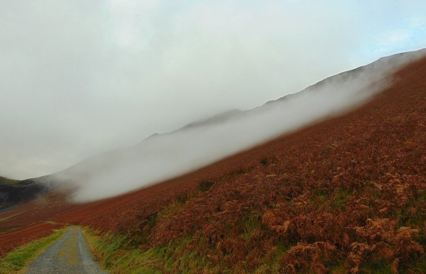 very low  cloud hovers over the fell
