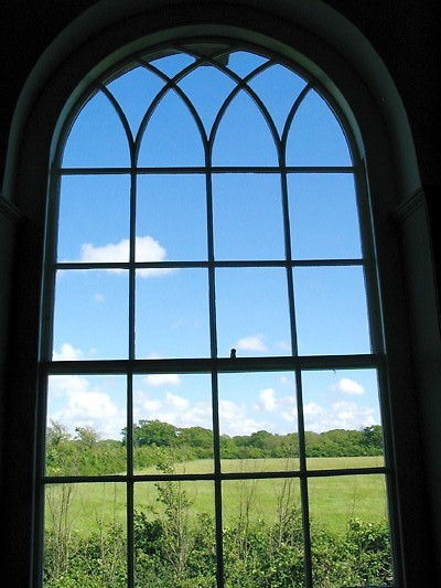 Newtown Town Hall, viewed through the window to the fields beyond