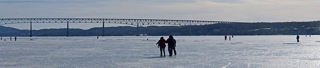 Kingston-Rhinecliff Bridge and walkers on frozen Hudson River
