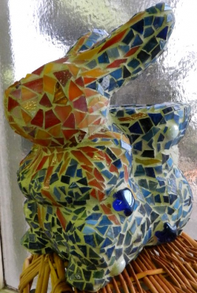 Paper mache object covered in glass