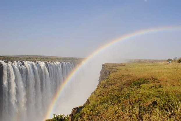photo-of-rainbow-over-waterfall