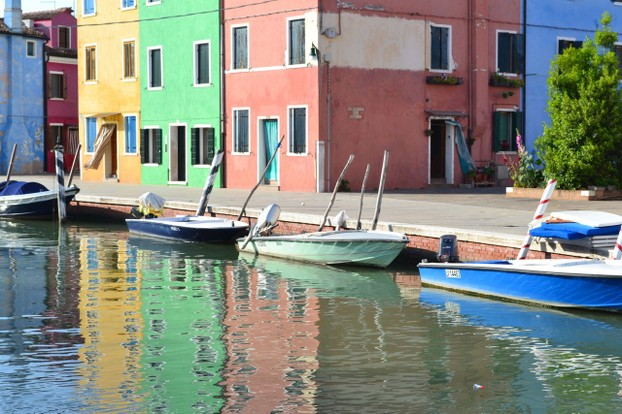 Reflections on a quiet Burano canal
