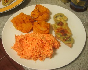 Kiwi chicken with potato puffs and carrot salad