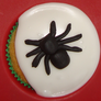 Put the spiders on the cakes