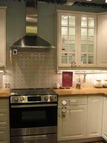 WHite glass door cabinets and stainless range hood