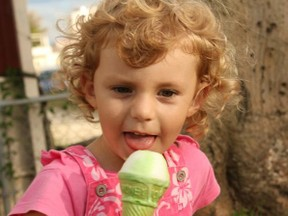 Sahratia ~ aged 3 eating an ice cream in the local park