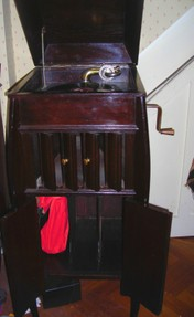 antique phonograph showing oak cabinet with slats
