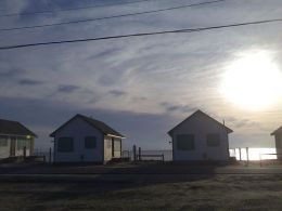 The rows of beautiful, identical shorefront cottages in Truro, Cape Cod.
