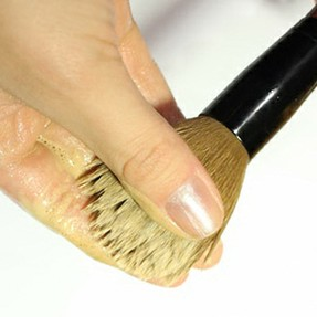 How do you clean makeup brushes?