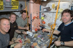 Image: Astronauts on the ISS eating a meal.