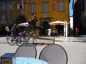 Cafe's in Piazza home of Puccini statue