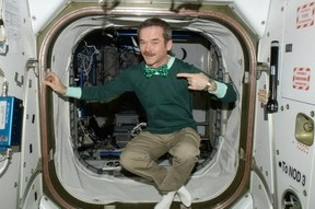 Image: Chris Hadfield wearing the green on the ISS.