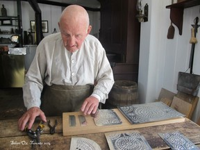 Tinsmith shows us materials ready to be made into a lamp