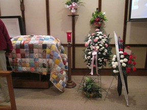 casket with quilt