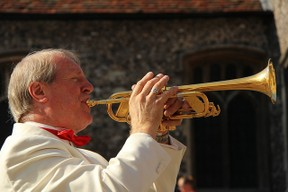 blowing trumpet