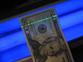 U.S. $20 bill under blacklight