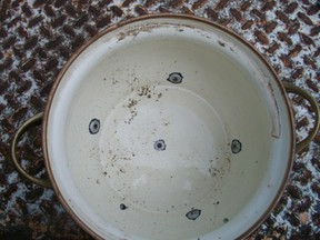 inside of pot with drilled holes