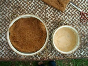 Line bottom of pots with coco or coffee filters