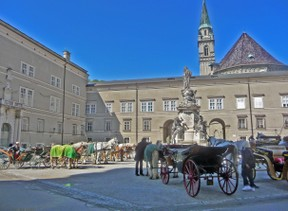 Carriages Await Passengers in Cathedral Square